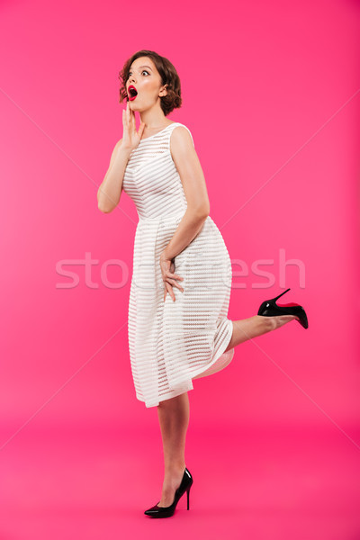 Full length portrait of an astonished girl Stock photo © deandrobot