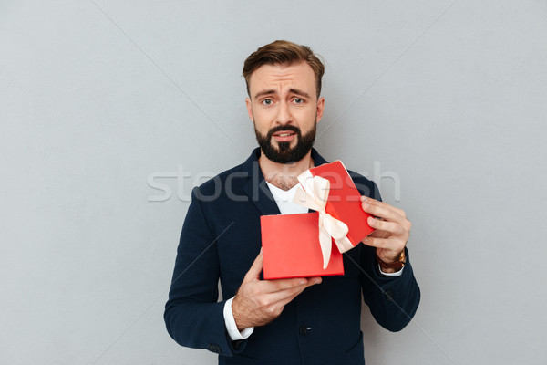 Alterar triste hombre traje regalo Foto stock © deandrobot