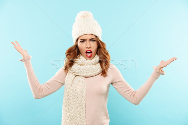 Angry lady with opened mouth looking camera isolated Stock photo © deandrobot