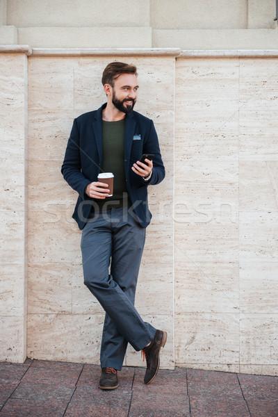 Tam uzunlukta portre yakışıklı gülen adam Stok fotoğraf © deandrobot