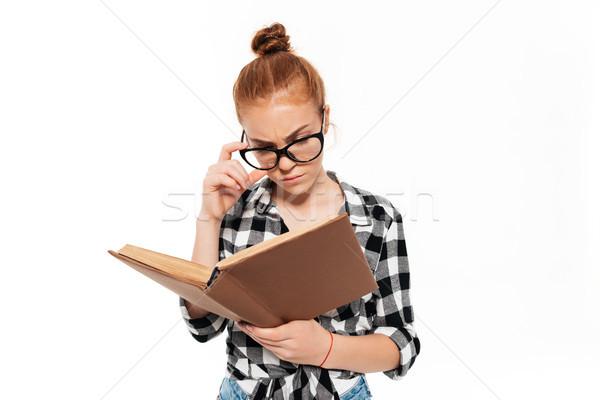 Koncentrált gyömbér nő szemüveg olvas könyv Stock fotó © deandrobot