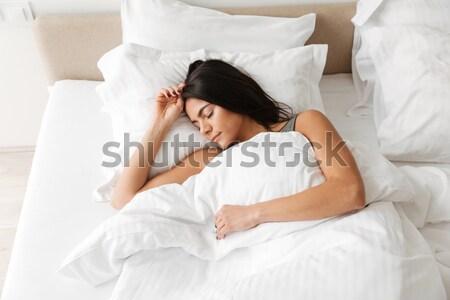 Retrato morena mulher adormecido casa cama Foto stock © deandrobot