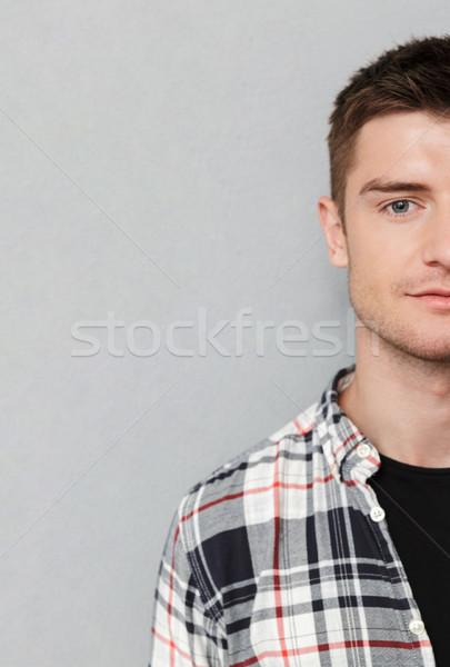 Half portrait of a serious man Stock photo © deandrobot