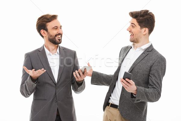 Portré kettő elégedett üzletemberek tart mobiltelefonok Stock fotó © deandrobot