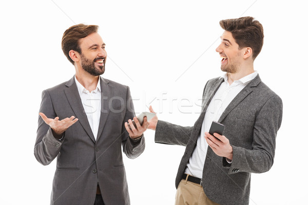 Portret twee tevreden zakenmannen mobiele telefoons Stockfoto © deandrobot