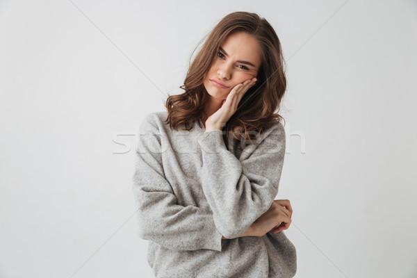 Ontdaan brunette vrouw trui aanraken wang Stockfoto © deandrobot