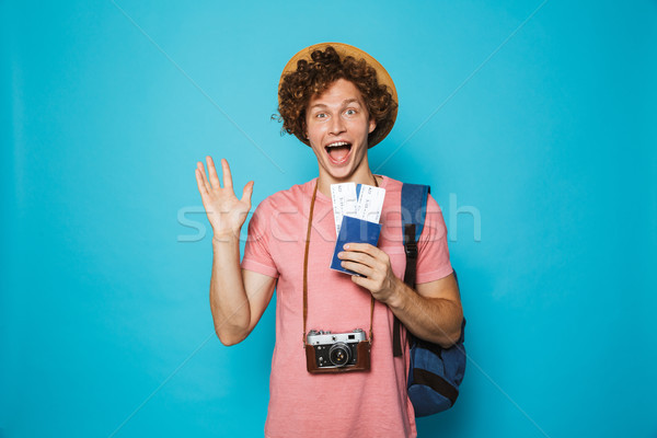 Photo of happy traveler man 18-20 with curly hair wearing backpa Stock photo © deandrobot
