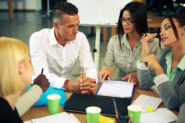 Business people having meeting around table in office Stock photo © deandrobot