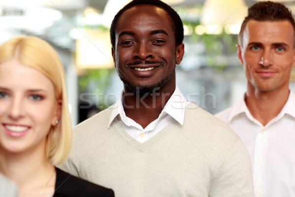 Retrato feliz grupo pessoas de negócios escritório reunião Foto stock © deandrobot