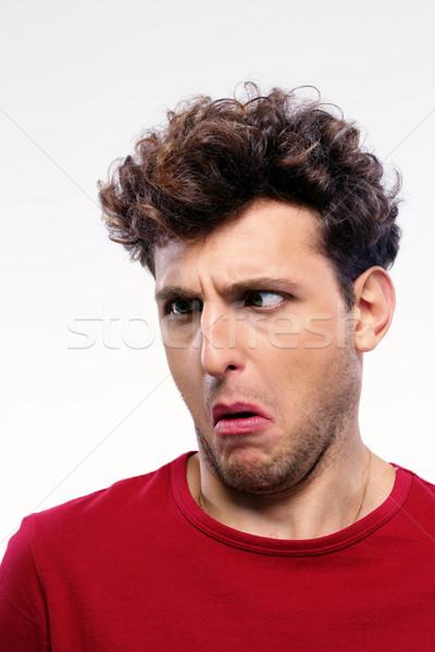 молодым человеком недовольный лице человека фон Сток-фото © deandrobot