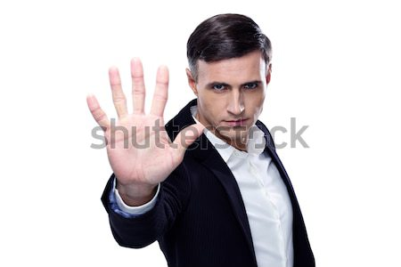 Buisnessman making stop gesture over white background Stock photo © deandrobot