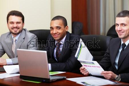 Többnemzetiségű üzleti csapat megbeszélés boldog diák laptop Stock fotó © deandrobot