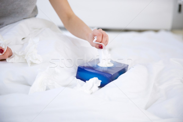Closeup image of a female hand pulls out a napkin from the box Stock photo © deandrobot