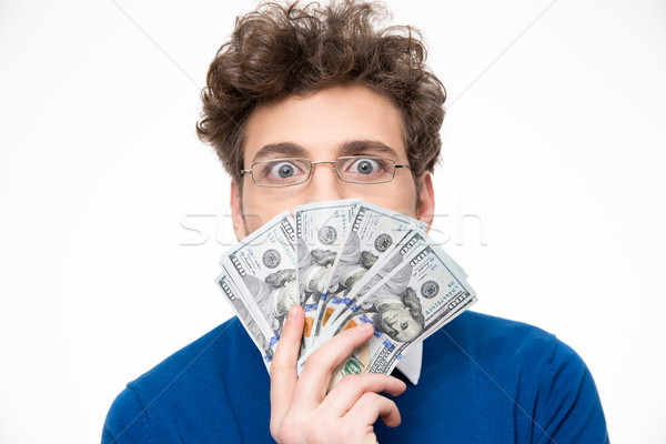 Stock photo: Handsome man with money over gray background
