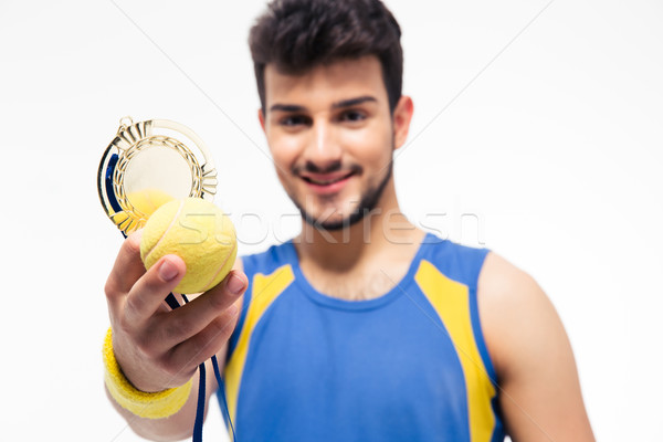 Happy sports man holding medal and tennis ball Stock photo © deandrobot