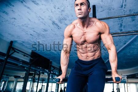Gespierd man training crossfit gymnasium knap Stockfoto © deandrobot