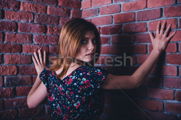 Portrait of a scared young woman Stock photo © deandrobot