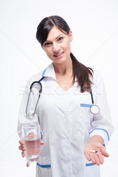 Médecin médication verre eau heureux Photo stock © deandrobot