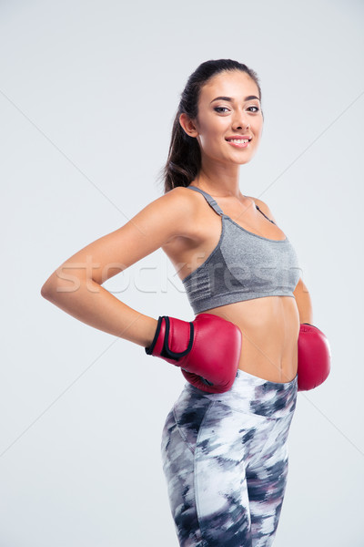 Stock photo: Smiling fitness girl standing in boxing gloves