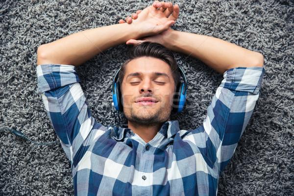 Man relaxing on the floor  Stock photo © deandrobot