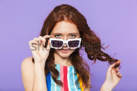 Beautiful sensual young girl in sunglasses looking on macarons Stock photo © deandrobot