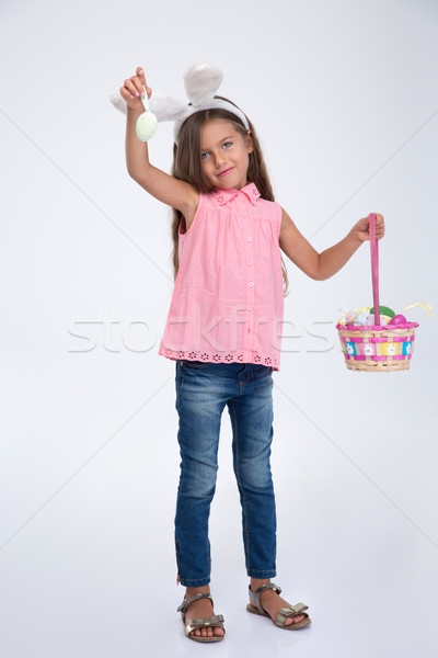 Little girl with bunny ears holding basket of egg Stock photo © deandrobot