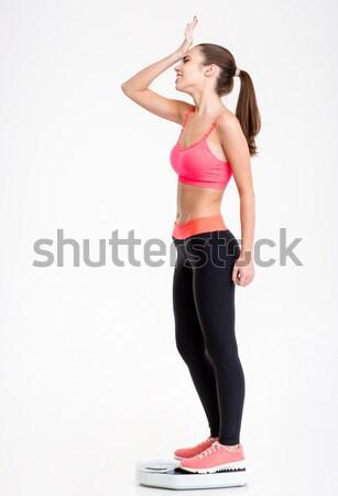 Sconvolto deluso fitness ragazza piedi scala Foto d'archivio © deandrobot