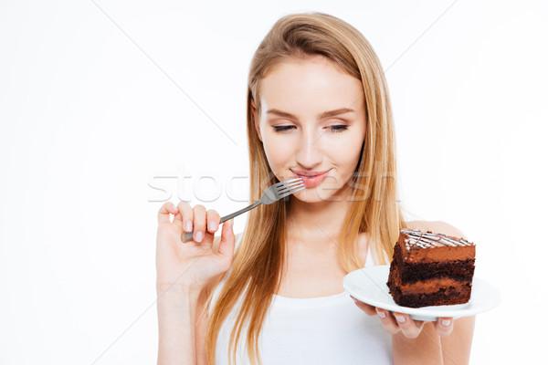 Aranyos figyelmes nő gondolkodik tart darab Stock fotó © deandrobot