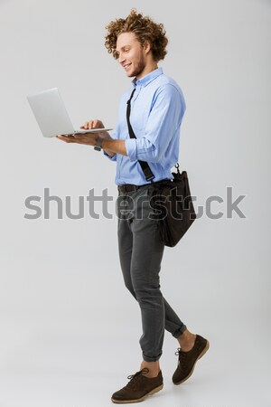 Happy woman using tablet computer Stock photo © deandrobot