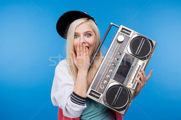 Female teenager holding retro boom box Stock photo © deandrobot