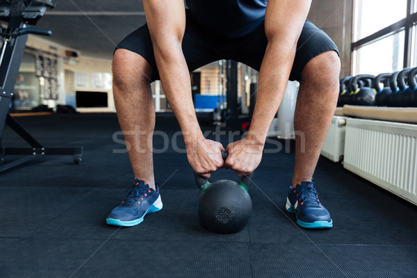 Bodybuilder working out with kettlebell Stock photo © deandrobot