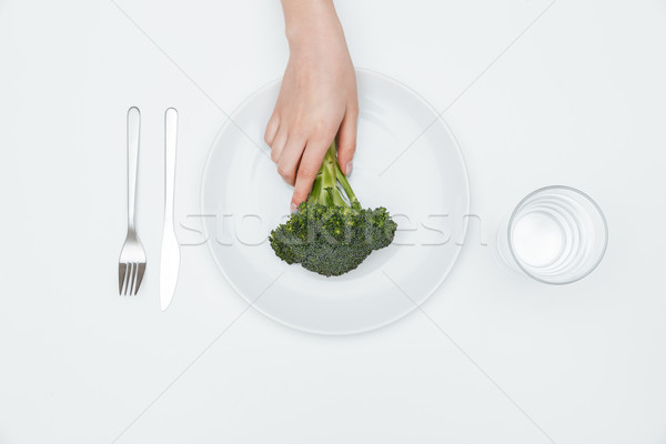 Haut vue femme main brocoli Photo stock © deandrobot
