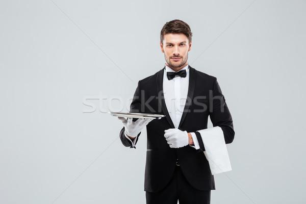 Aantrekkelijk butler smoking permanente zilver Stockfoto © deandrobot