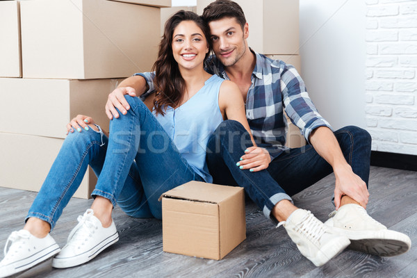 Young married couple sitting in their new house Stock photo © deandrobot