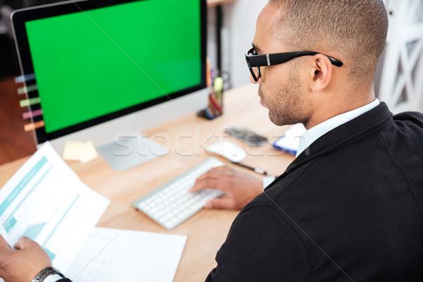 Businessman working with documents in office Stock photo © deandrobot