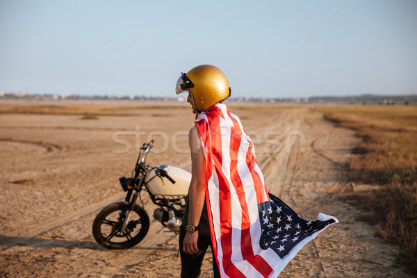 Man wearing american flag cape and golden helmet Stock photo © deandrobot