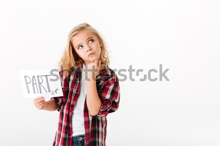 Beautiful young woman standing with hands in pockets Stock photo © deandrobot