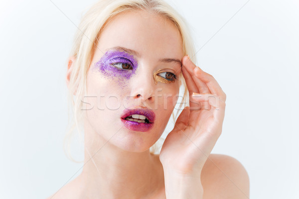 Beauty portrait of cute young woman with fashion makeup Stock photo © deandrobot