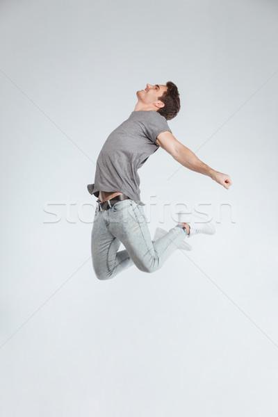 Positivo despreocupado casual joven saltar aire Foto stock © deandrobot