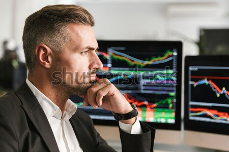 Angry irritated bearded young businessman screaming in smartphone Stock photo © deandrobot