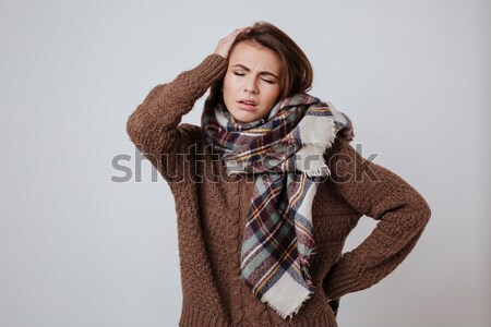 Thoughful woman in sweater and scarf Stock photo © deandrobot