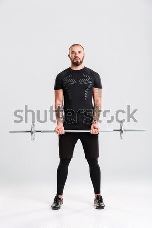 Fitness man with barbell Stock photo © deandrobot