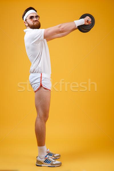 вид сбоку спортсмен осуществлять глядя камеры Сток-фото © deandrobot
