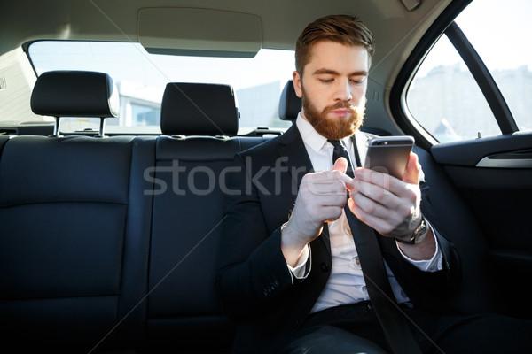 élégant barbu homme d'affaires costume téléphone portable Retour Photo stock © deandrobot