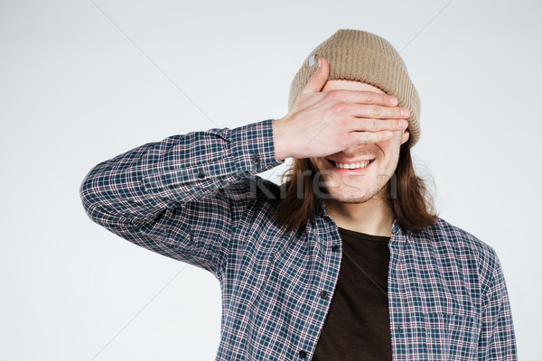 Happy Hipster covering his eyes Stock photo © deandrobot