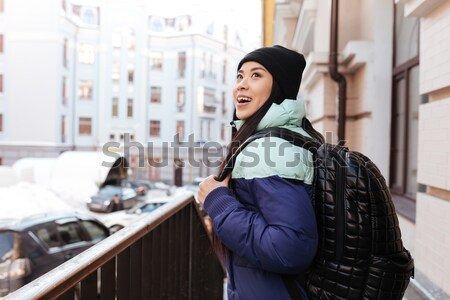 Side view of Young Asian woman in warm clothes Stock photo © deandrobot