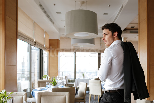 Back view of man in restaurant Stock photo © deandrobot