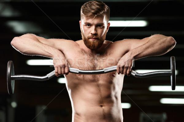 Zagęszczony sportowe człowiek sportu sztanga Zdjęcia stock © deandrobot