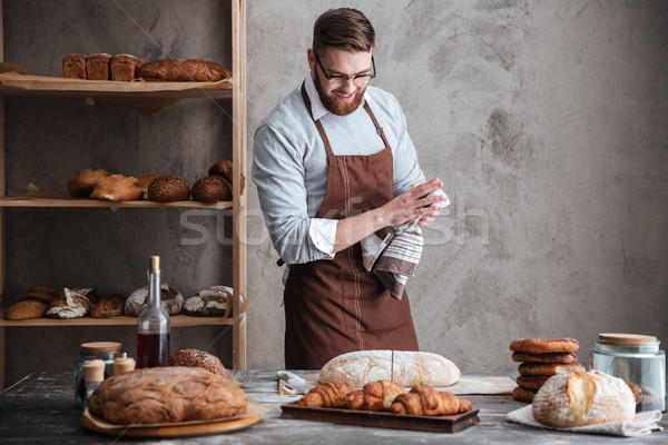 Stock photo: Young cheerful bearded man wearing glasses baker