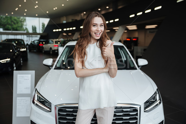Amazing young happy woman standing near car Stock photo © deandrobot